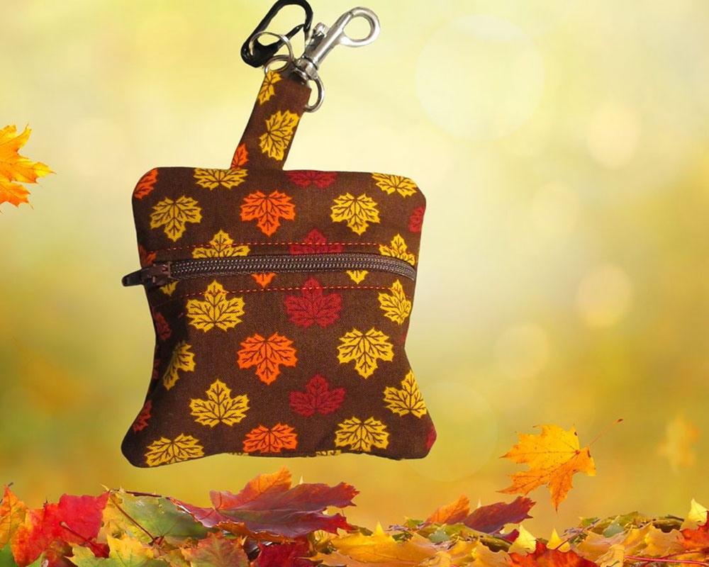 Autumn leaves dog poop bag holder or doody diaper bag holder. Free roll of bags handmade in USA by A Fur Baby Favorite